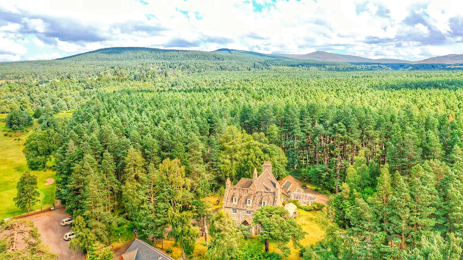 Aerial photo of the Grey House surrounded by Abernethy Forest